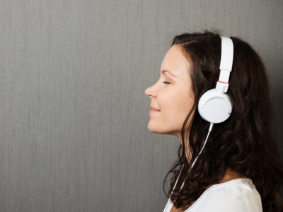 Girl meditate headphones